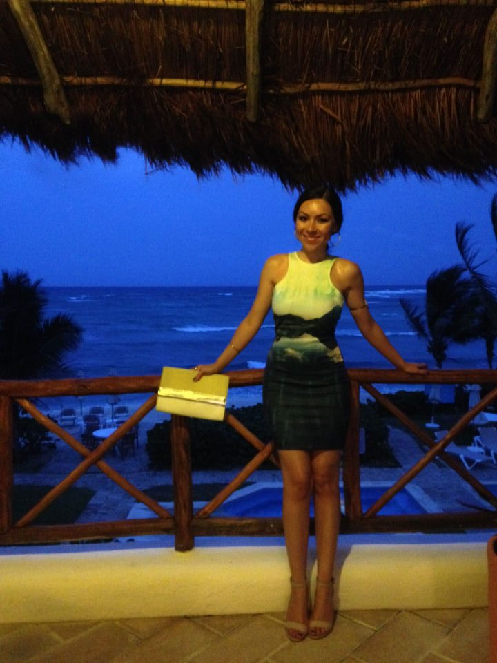 Nihan Gorkem showing her outfit of the night, an ocean printed dress, in Tulum Mexico