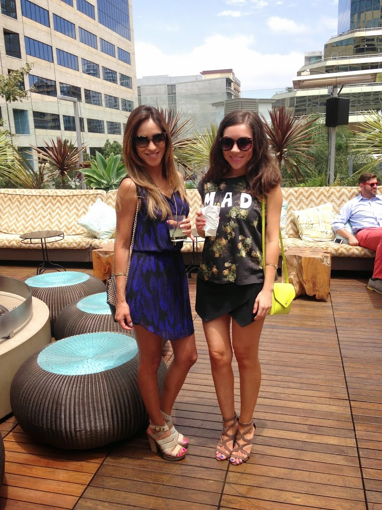 Blogger Nihan and her friend showing her black and green fun summer brunch outfit by the pool at the W Hotel in San Diego