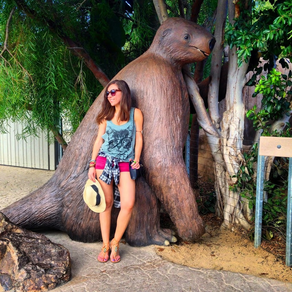 Blogger Nihan posing with the sloth and showing her outfit at the San Diego Zoo