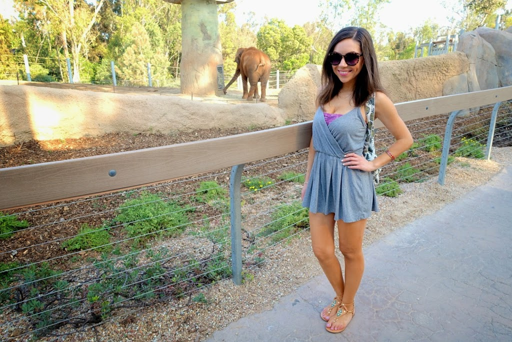 Blogger Nihan showing her outfit, a casual grey romper and a pineapple backpack at the San Diego Zoo
