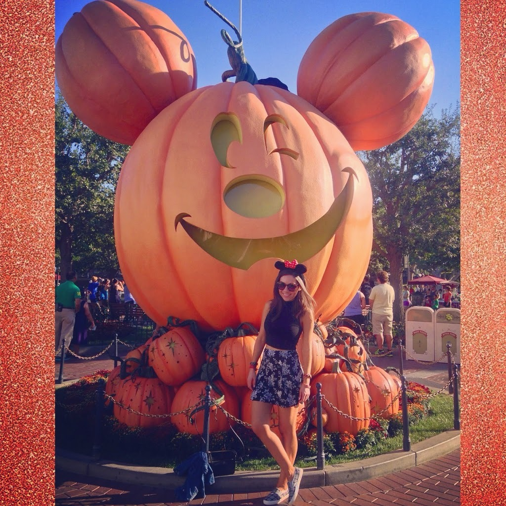 Blogger Nihan posing in front of the huge  Mickey Pumpkin in Disneyland during Halloween Time