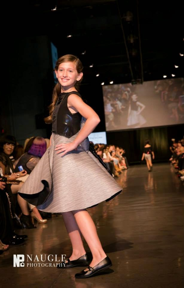 Pretty teenage girl model walking down the runway on Fashion Week San Diego 2014 Night 2