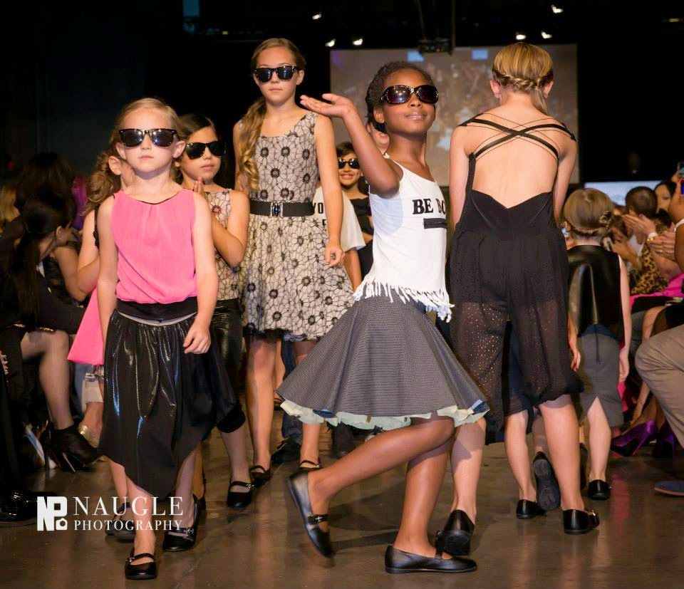 Cute child models walking down the runway on Fashion Week San Diego 2014 Night 2