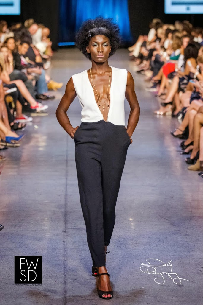 Model wearing a black and white romper walking down the runway during Fashion Week San Diego 2014 Night 3