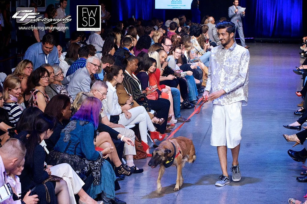 Male Model and a cute puppy from Rancho Coastal Humane Society walking down the runway on Fashion Week San Diego 2014 Night 2