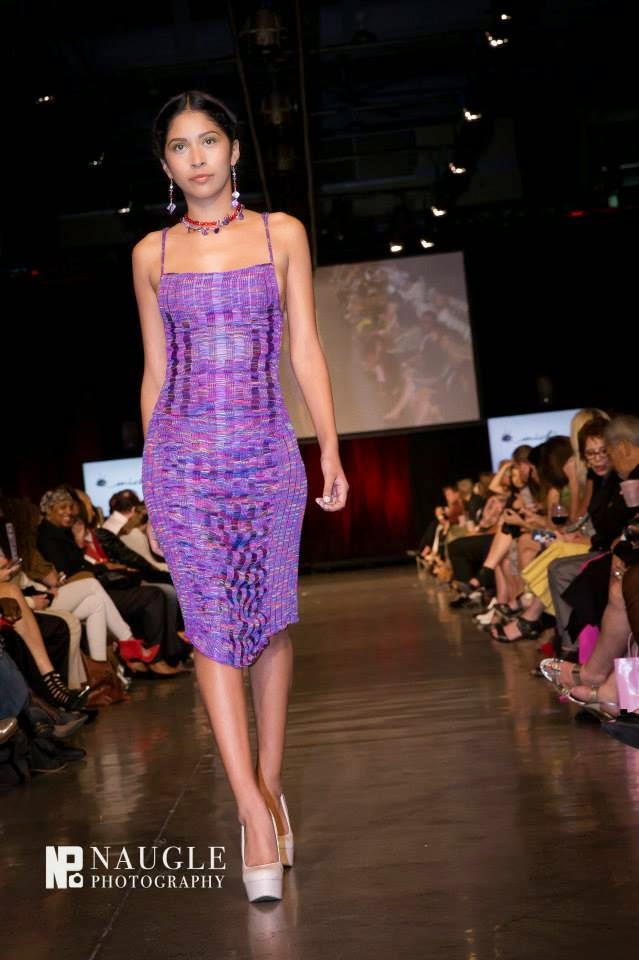 Model in purple dress walking down the runway on Fashion Week San Diego 2014 Night 2