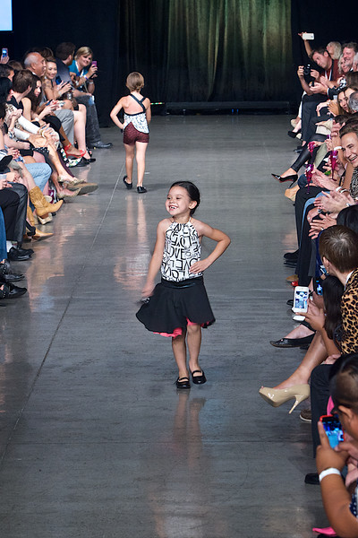 Cute little girl model walking down the runway on Fashion Week San Diego 2014 Night 2