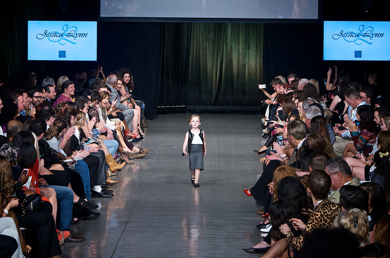 Little cute girl model walking down the runway on Fashion Week San Diego 2014 Night 2