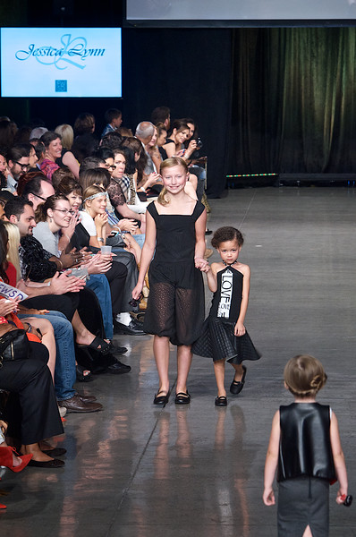 Pretty teenage girl and a little girl model walking down the runway on Fashion Week San Diego 2014 Night 2
