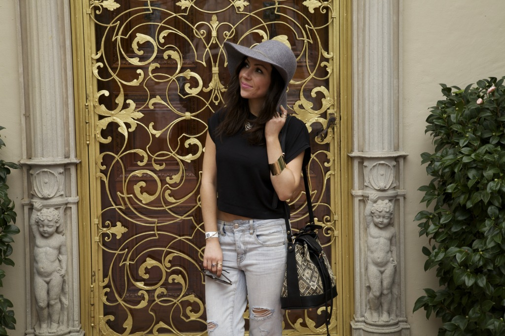 Blogger Nihan wearing black H&M top and tiger necklace while visiting Hearst Castle