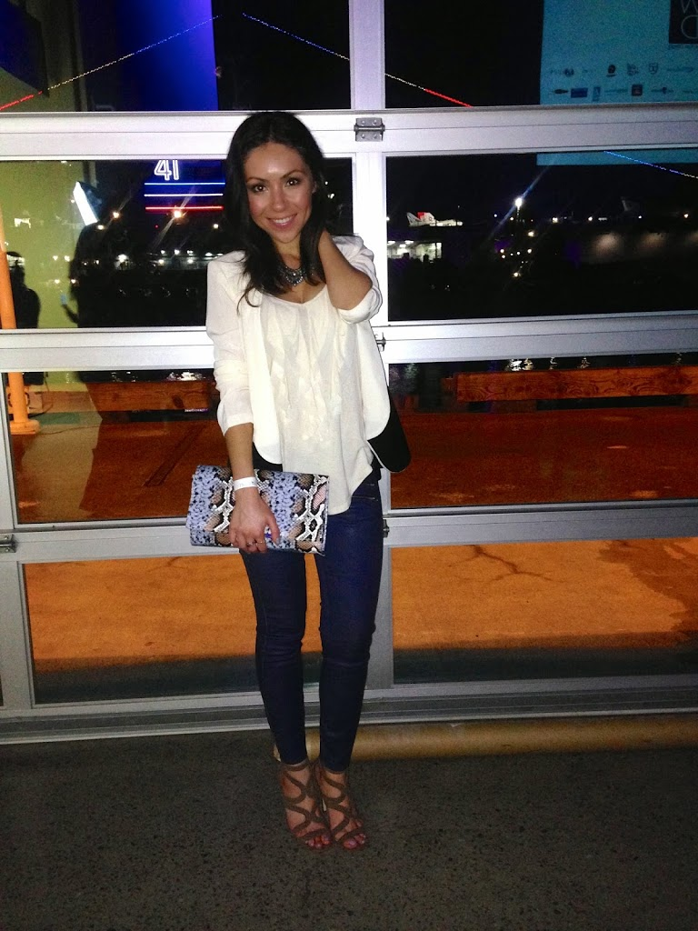Blogger Nihan smiling and showing her outfit at  Fashion Week San Diego 2014 Night 2