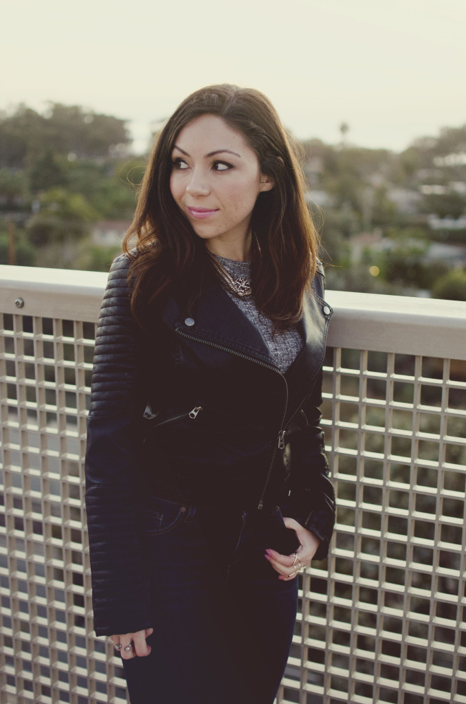 Blogger Nihan posing and looking back, showing her edgy and cool leather jacket