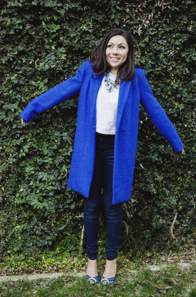 Fashion model wearing an Oversized blue coat and being funny
