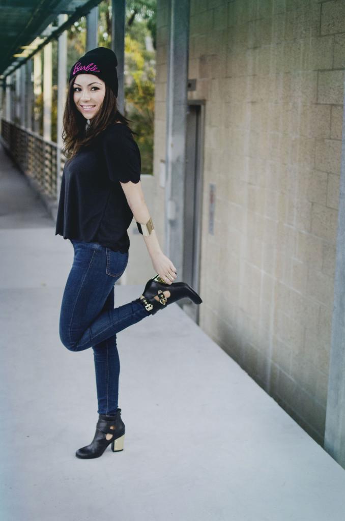 Girl wearing fancy black booties