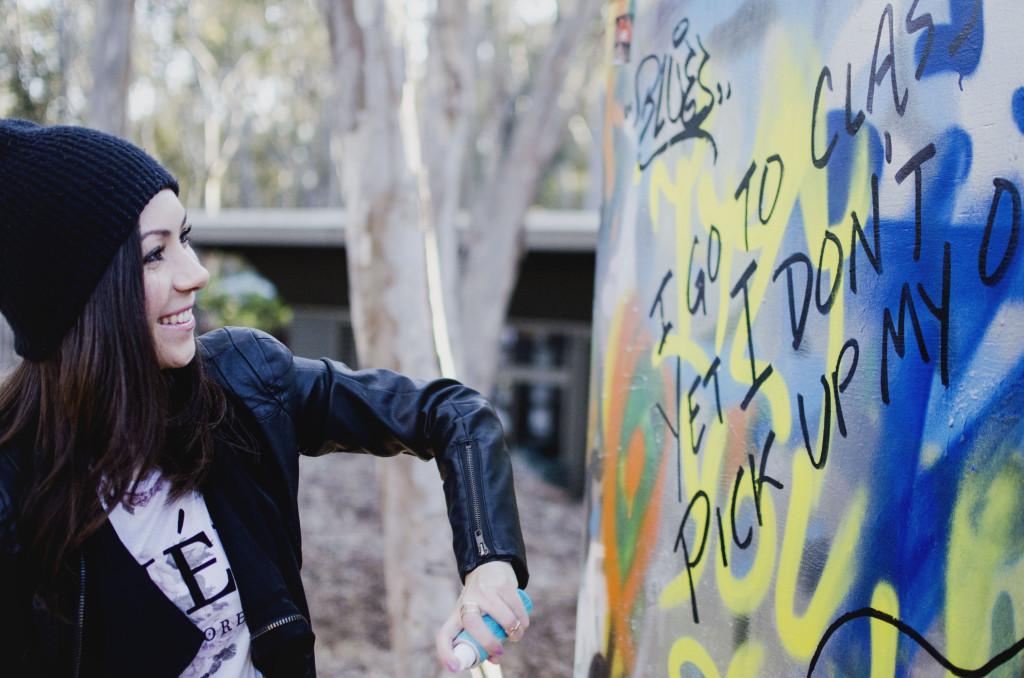 Model painting a graffiti in ucsd graffiti park