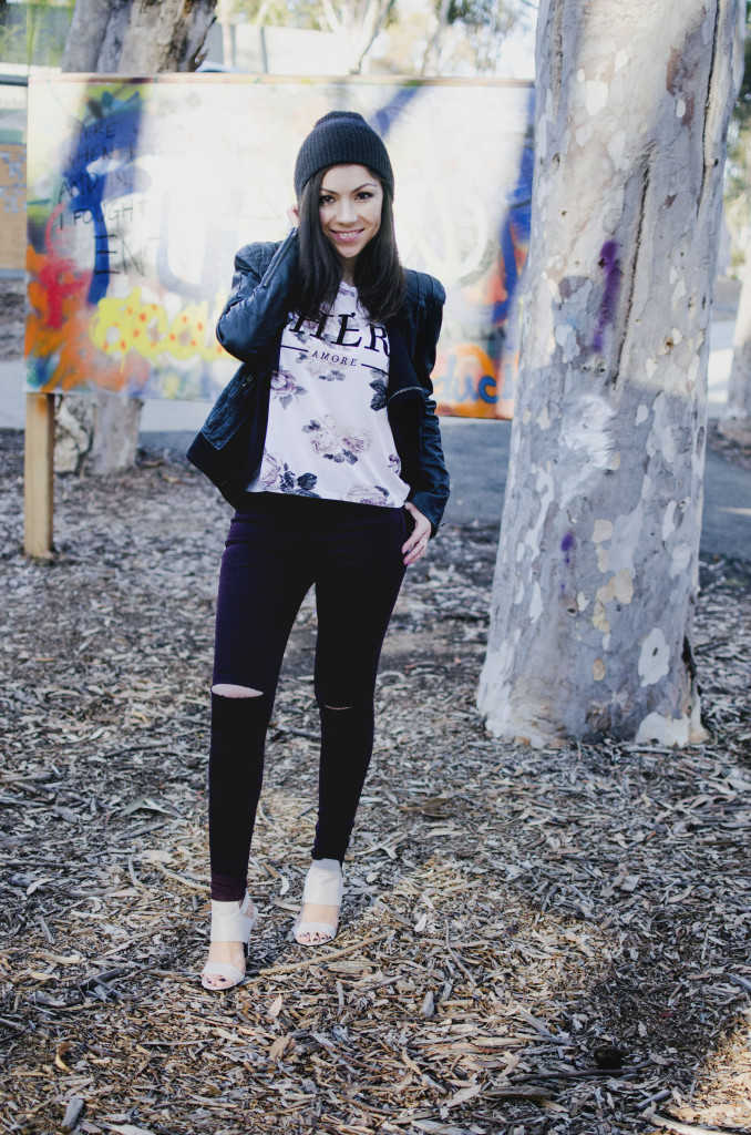 Model posing and showing her outfit in a graffiti park