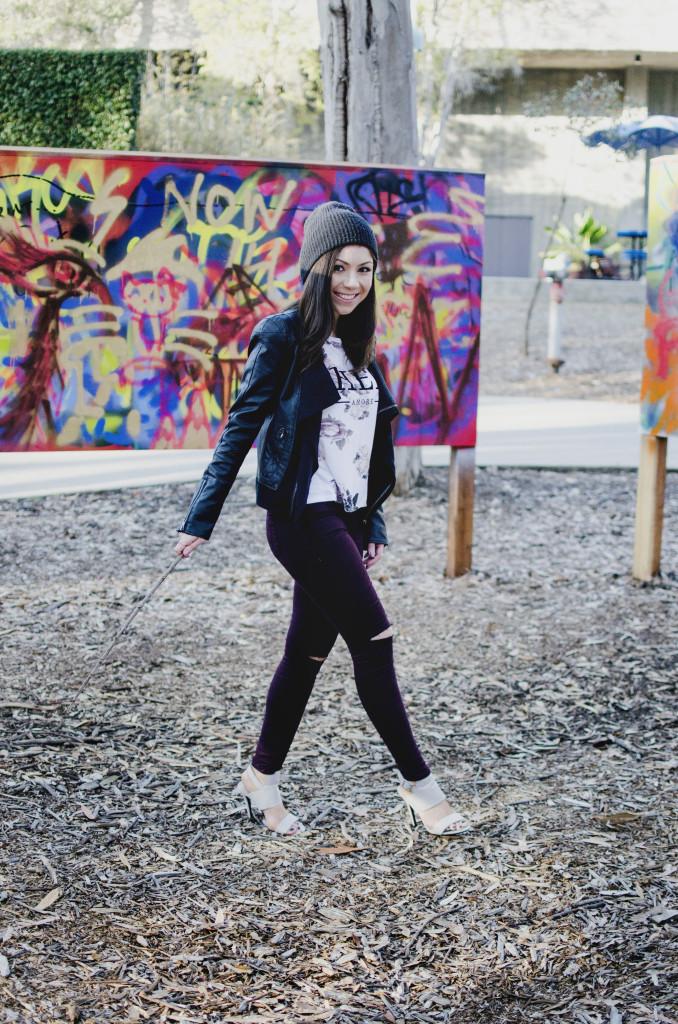 Model walking in a graffiti park