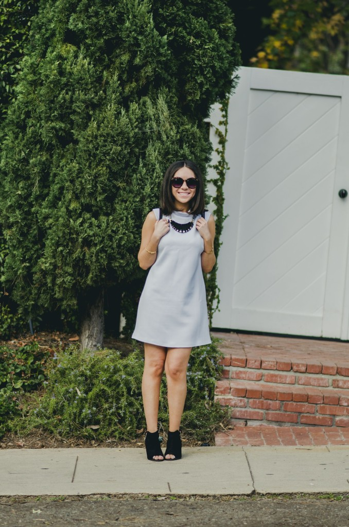 Nihan Gorkem wearing baby blue Asos mod dress black and gold Nasty Gal backpack JustFab black open toe booties and jewelry - winter baby blues
