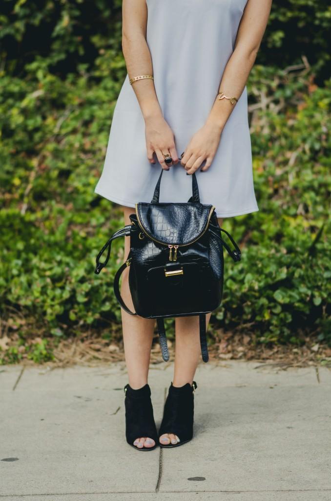 Nihan Gorkem wearing baby blue mod dress black gold backpack black open toe booties - winter baby blues
