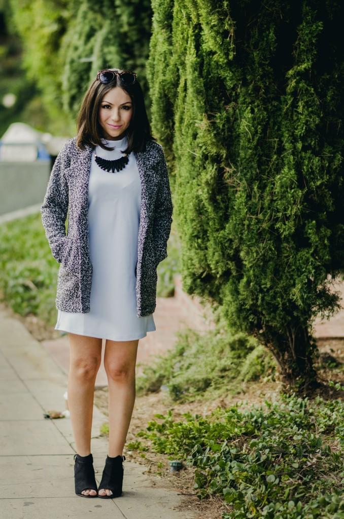 Nihan Gorkem wearing baby blue mod dress black and white tweed coat black open toe booties and posing - winter baby blues