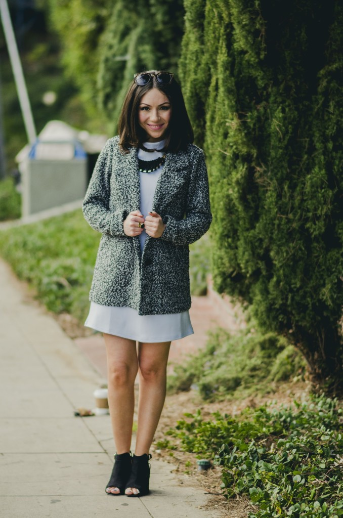 Nihan Gorkem wearing baby blue mod dress grey white coat black and gold backpack black open toe booties and jewelry - winter baby blues