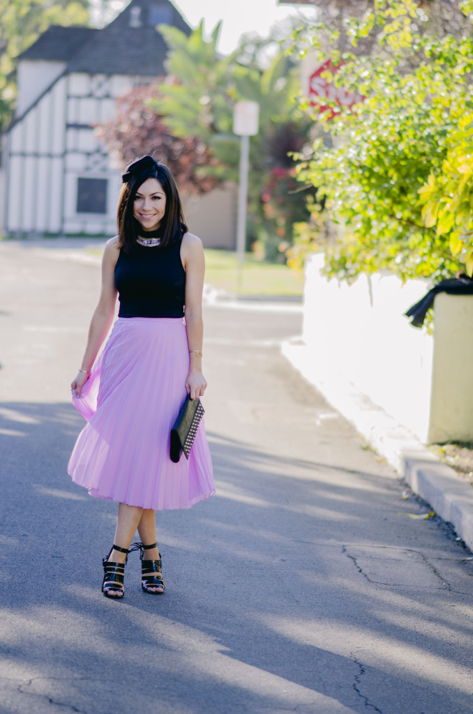 Style with Nihan wearing romantic Asos pleated pink maxi skirt, black top, black Topshop high heels, Topshop leather jacket and fancy head piece | Pink Valentine