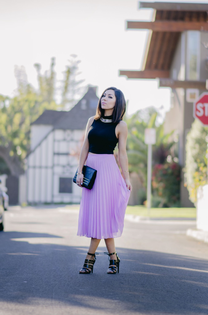 Style with Nihan wearing romantic Asos pleated pink maxi skirt, black top, black Topshop high heels, Topshop leather jacket and H&M studded purse | Pink Valentine