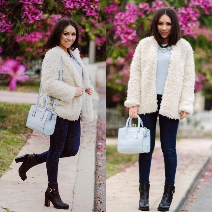 Nihan wearing a white H&M Fur Coat, Baby Blue River Island Purse, Topshop jeans and JustFab Boots