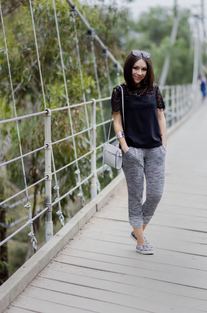 Nihan showing her ootd, grey sweatpants, grey sneakers, black Topshop lace top and white purse