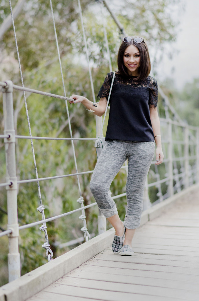 Nihan wearing sweatpants, sneakers and a black lace top at Suspension Bridge
