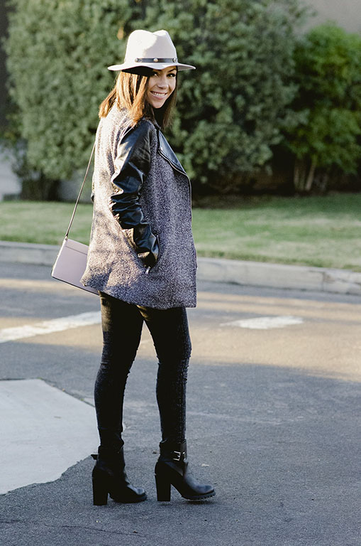 Blogger Nihan wearing a grey H&M jacket with black leather sleeves and cool edgy black buckled heeled booties