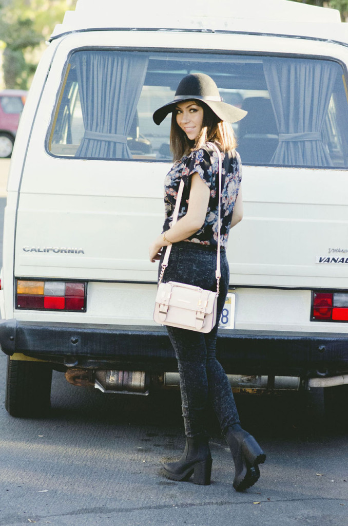 Nihan wearing ASOS floral shirt, H&M floppy hat, jeans, boots and River Island structured bag