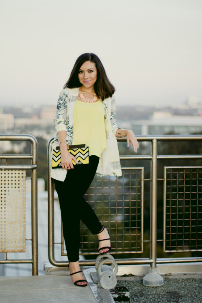 Stylist Nihan wearing Asos geometric printed blazer and Asos printed clutch