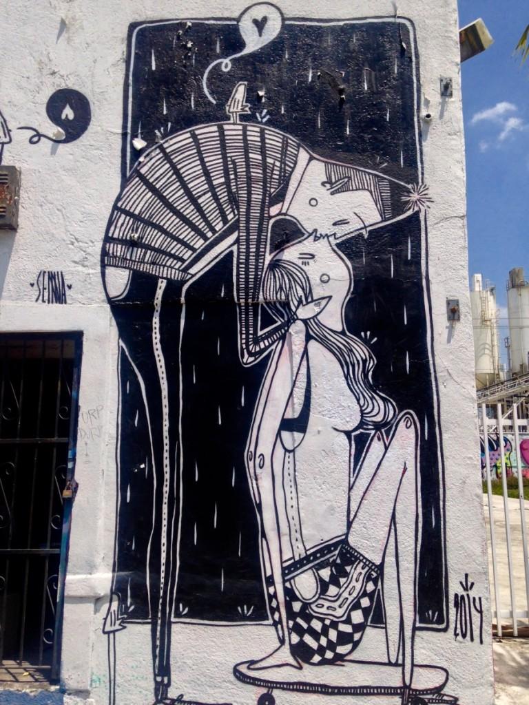 Kissing couple cartoon mural in Wynwood Walls, Miami