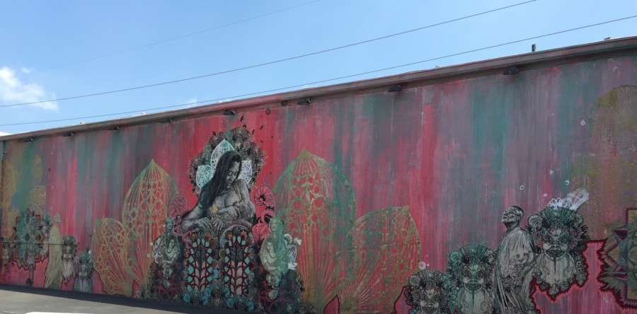 Mother breast-feeding her child mural by Swoon in Wynwood Walls Miami
