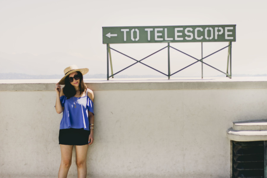 Nihan wearing perwinkle blue Topshop cold shoulder top, Brandy melville shorts and Lack of Color Spencer Fedora at Griffith Observatory in Los Angeles