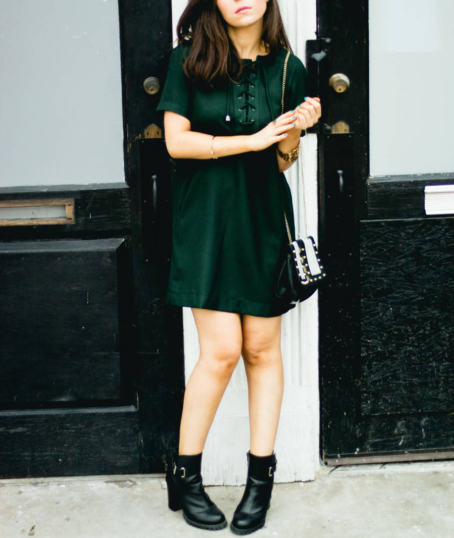 Fashion blogger Nihan wearing a Topshop mini dress and high-heeled boots from JustFab
