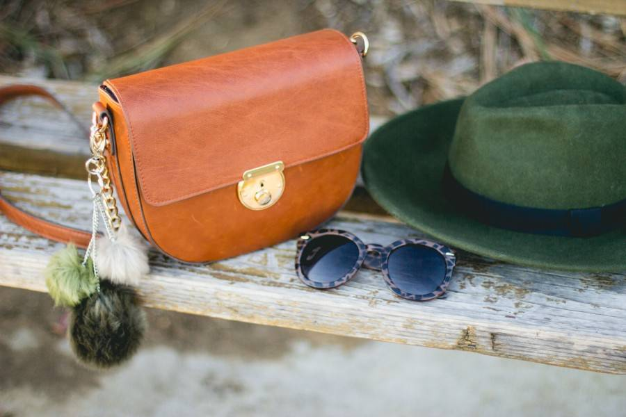 Green wool hat and brown purse