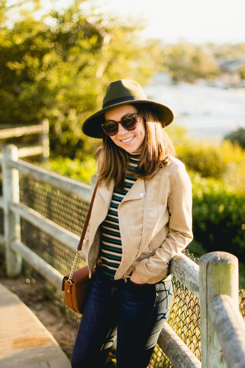 Green wool hat and tan biker jacket