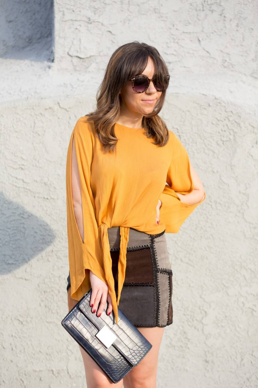 Zara leather patchwork skirt and mustard chic top