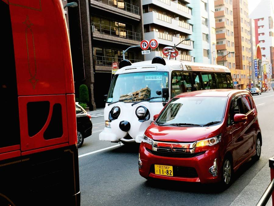 Cute blinking cars in Tokyo Japan