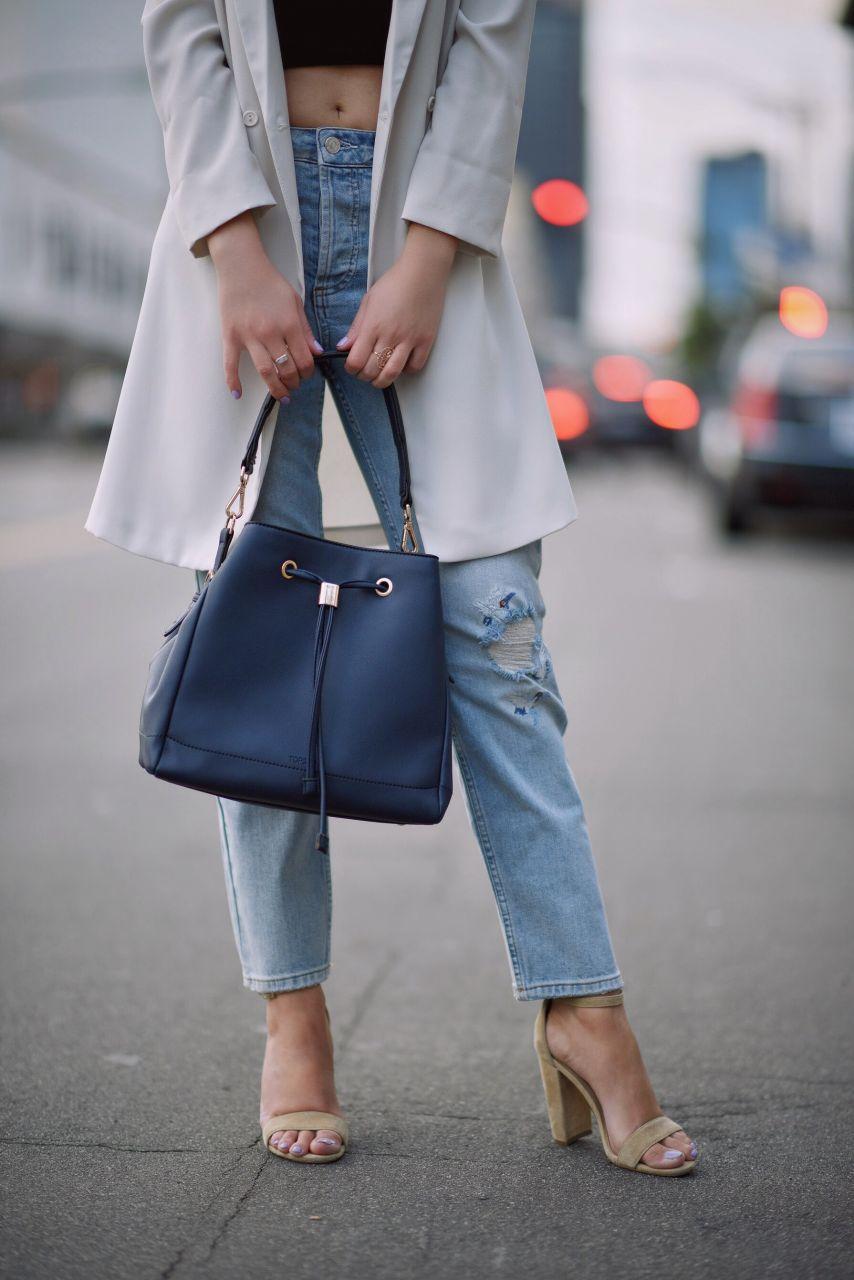 Topshop white blazer and boyfriend jeans, navy bucket bag