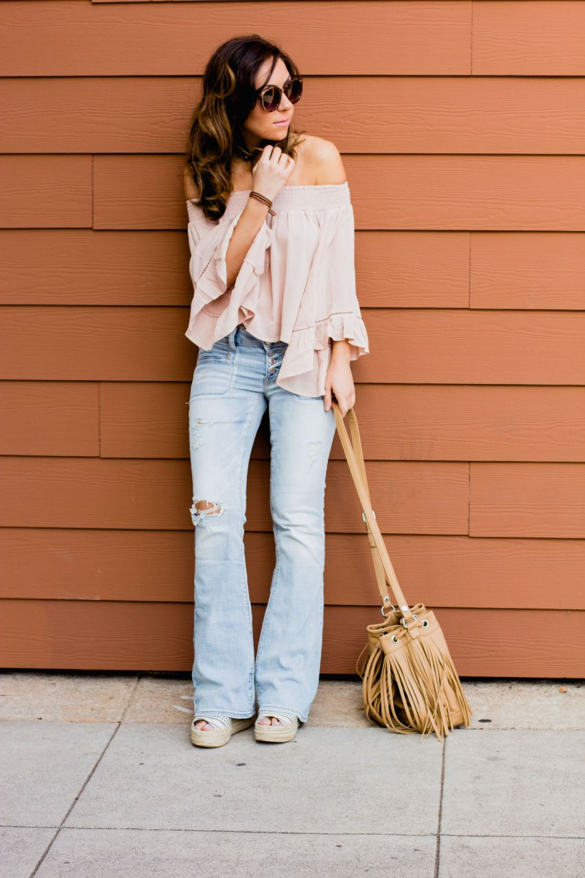 Flare jeans and off the shoulder bell sleeve top