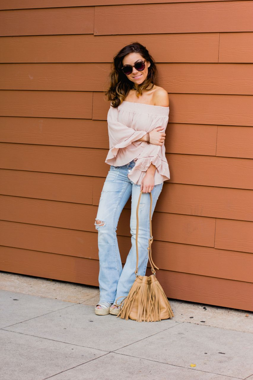 Flare jeans and off the shoulder bell sleeve top 3