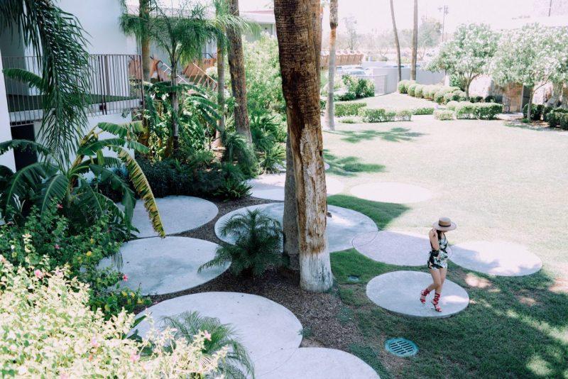 Nihancik walking in the Hotel Valley Ho garden wearing Topshop playsuit and Public Desire Ariel heels