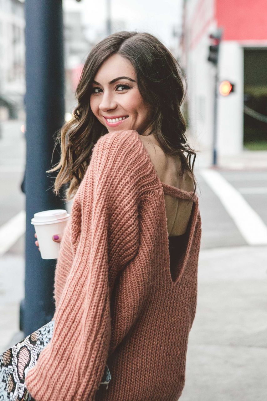 Style blogger Nihan Gorkem having coffee in downtown San Diego