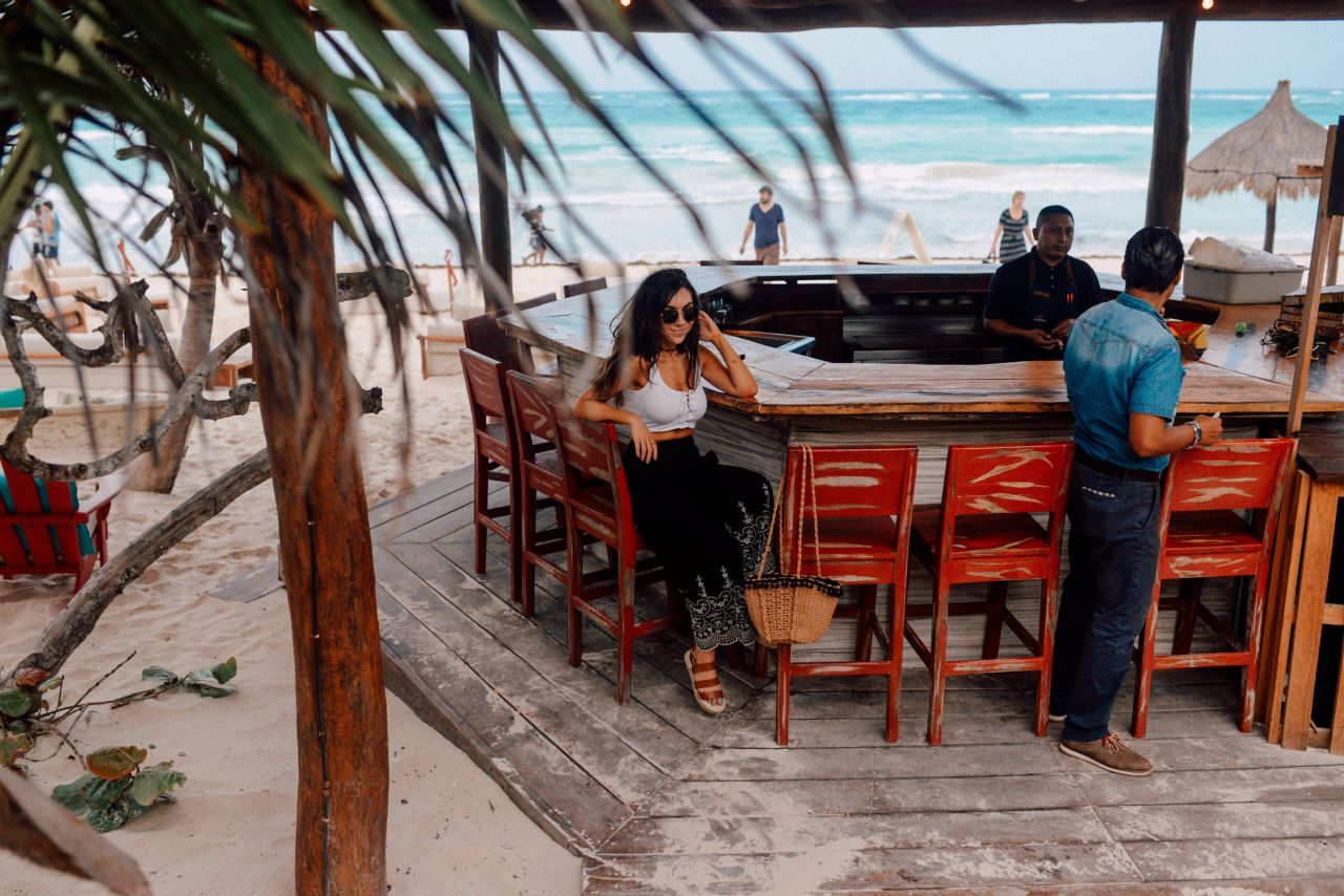 Boho chic in Tulum: Topshop Embroidered trousers and crop top