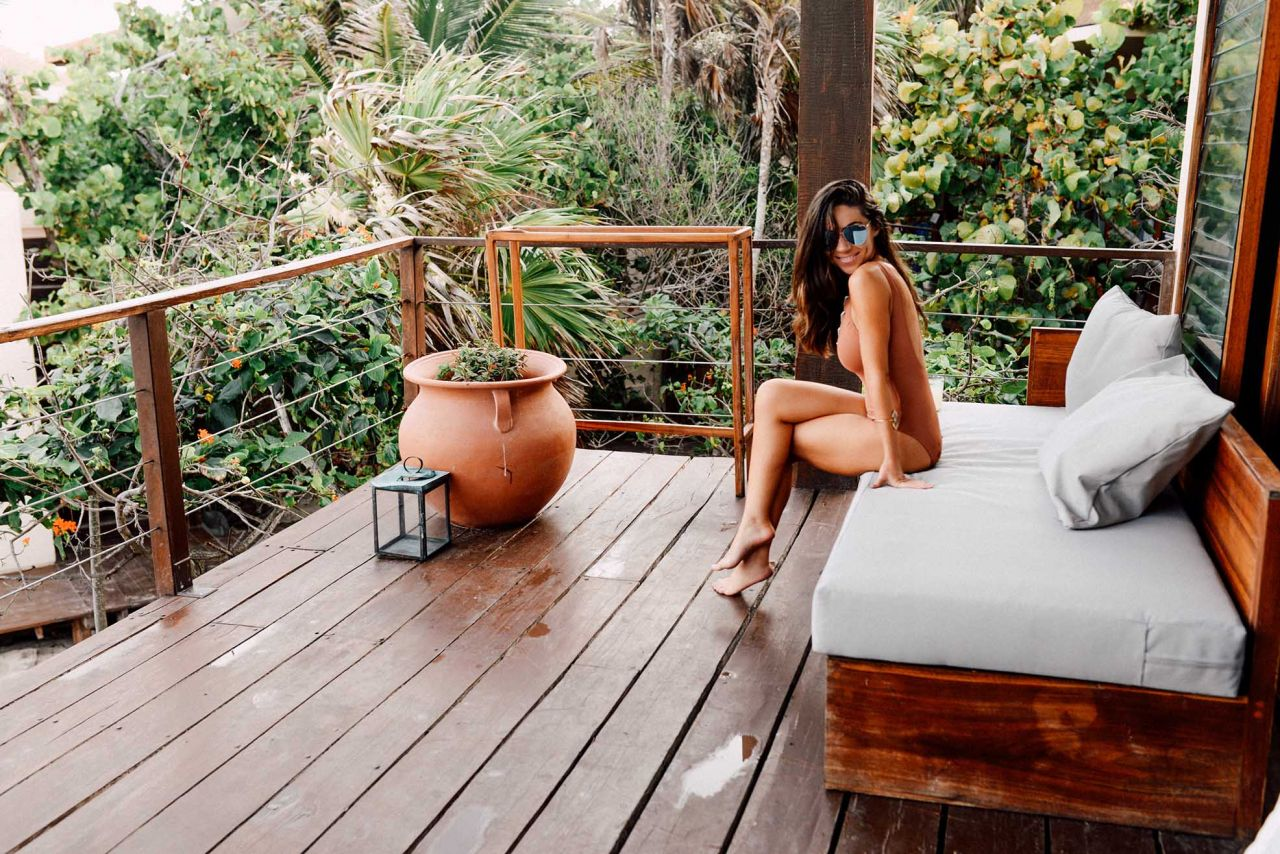 wearing one piece H&M swimsuit with lacing in La Zebra Hotel Tulum