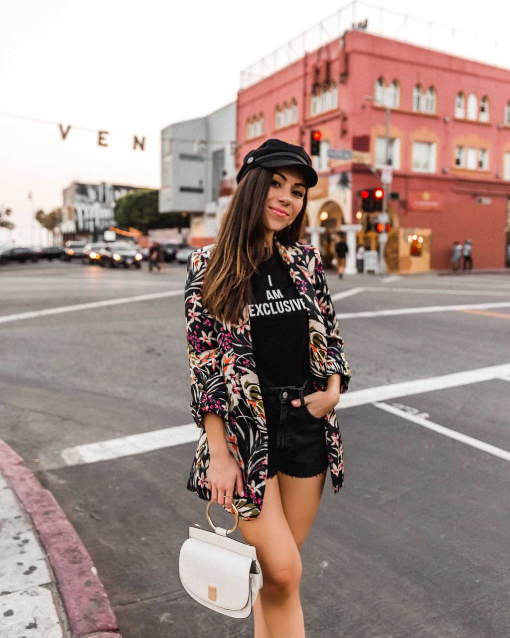 Floral blazer and baker boy hat in Venice Beach