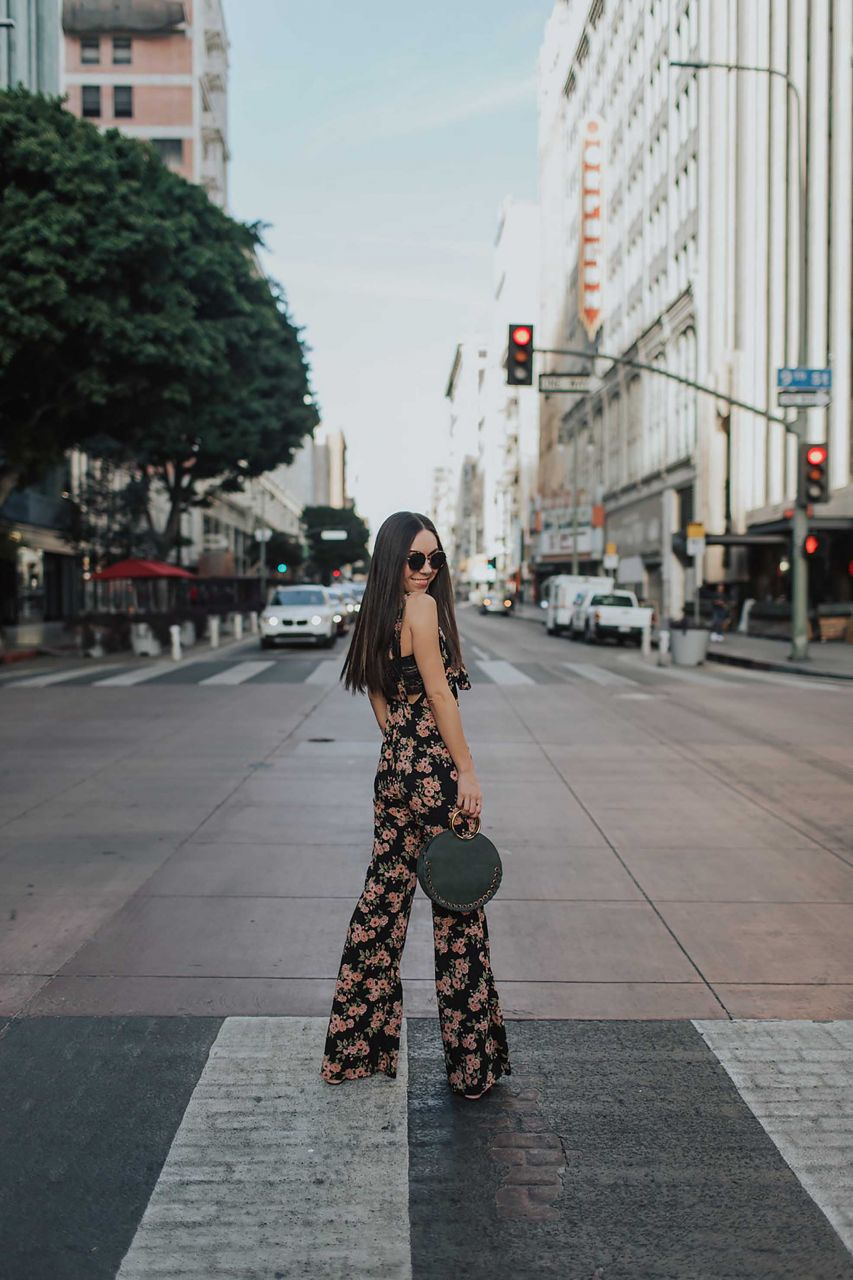 Channel Your Inner Flower Child In a Floral Jumpsuit